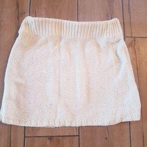 White sequin mini skirt.